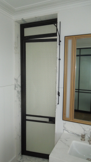blackened and lacquered stainless shower door