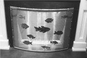 curved stainless screen w fish decorations