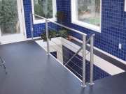stainless steel cable set into lacquered steel framework